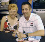 MMAJ graduate student Corri Filipowski hangs out with her favorite driver, Greg Biffle, at the Roush Museum in Livonia, Mich. in August 2007.  Biffle drives the #16 3M Ford Fusion for Roush Fenway Racing.